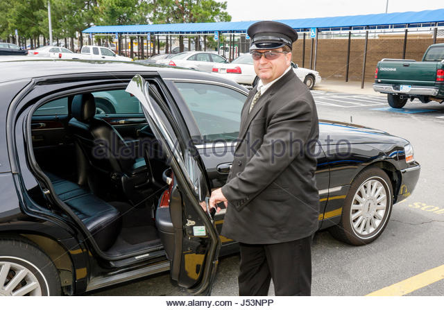 Little Rock Arkansas Little Rock National Airport man chauffeur driver limousine uniform service transportation - Stock Image