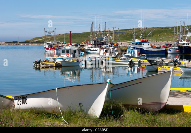 Fishing boats tied up at the wharf in Old Perlican, Newfoundland and Labrador, Canada. - Stock Image