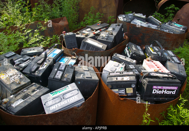 Car Batteries to be Recycled in Salvage Yard - Stock Image