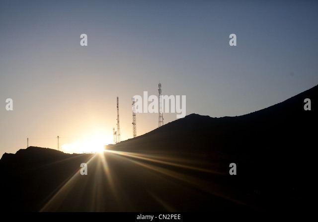 Mountains and communication towers in sunlight - Stock Image