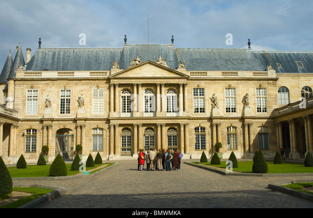 Tourists in front of National Archives buildings Le Marais district central Paris France Europe - Stock Image