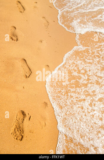 Background of sandy beach and ocean wave - Stock Image