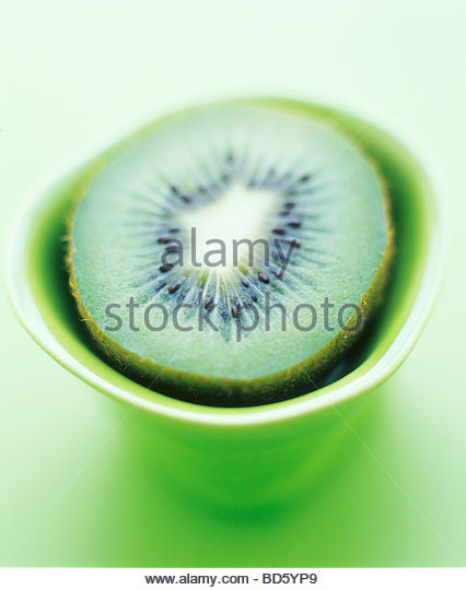 Half a kiwi fruit - Stock Image