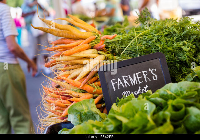 Fresh organic produce on sale at the local farmers market. - Stock Image