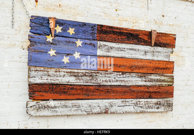 Painted wooden American flag replica. - Stock Image