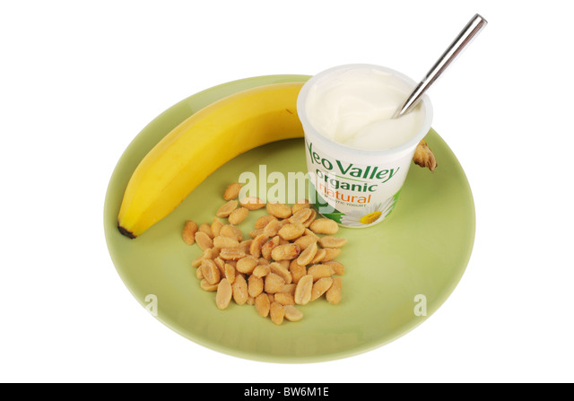 Yogurt with Banana and Salted Peanuts - Stock Image