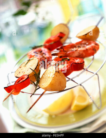Prawn, pepper and potato kebabs - Stock Image