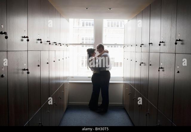 Couple office workers in locker room - Stock-Bilder