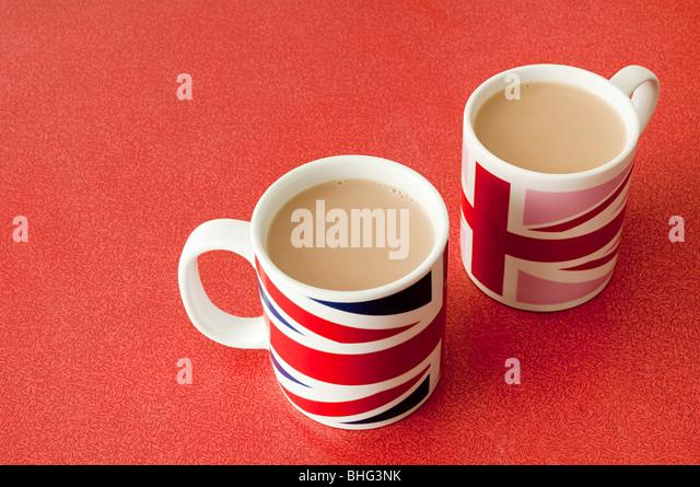 Cups of tea in union jack mugs - Stock Image