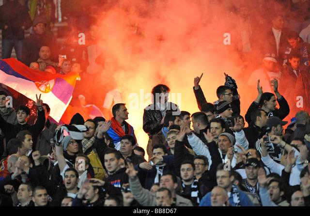 Hooligans lighting a bengali fire in the fanblock, Mercedes-Benz Arena, Stuttgart, Baden-Wuerttemberg, Germany, - Stock Image