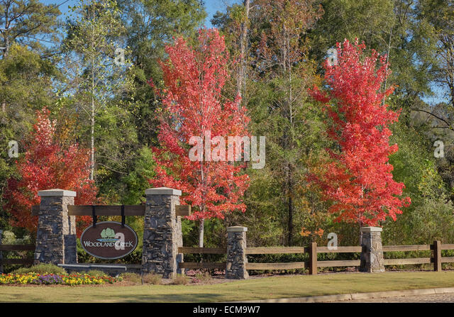 Entrance to Woodland Creek subdivision, a suburban housing estate, in Montgomery County, Pike Road Township, Alabama, - Stock Image