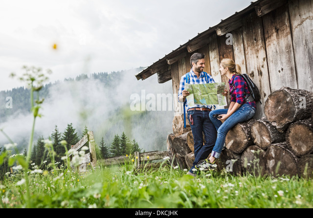 Couple with map discussing their trek, Tirol, Austria - Stock Image