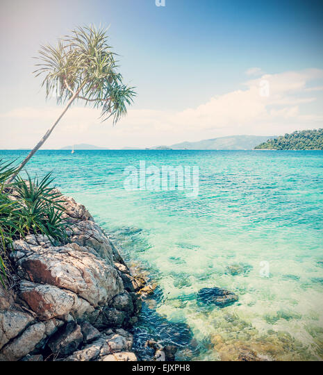 Cross processed picture of rocky shore, Koh Lipe, Thailand. - Stock Image