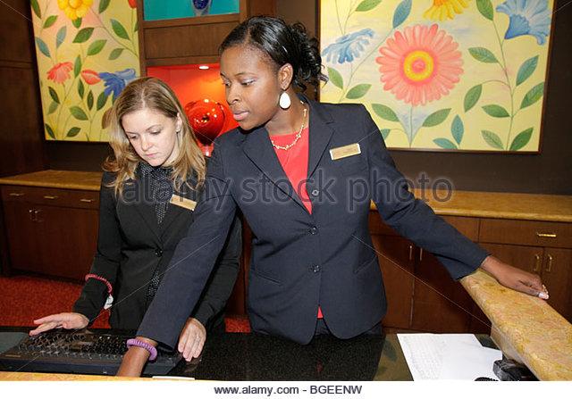 Charleston South Carolina Marriott Charleston hotel Black woman clerk front desk job lodging hospitality register - Stock Image