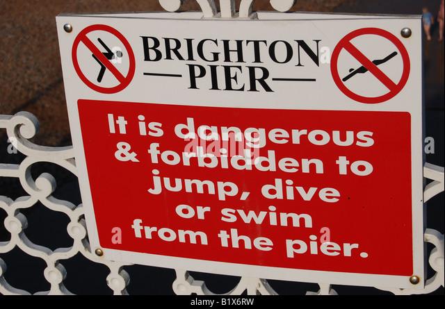 Danger sign at Brighton Pier, England - Stock Image