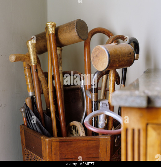 Collection of old fashioned walking and croquet sticks in an umbrella stand - Stock-Bilder
