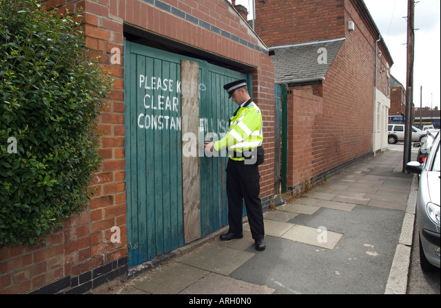 Community support officer on beat stock photos community for Coventry garage doors