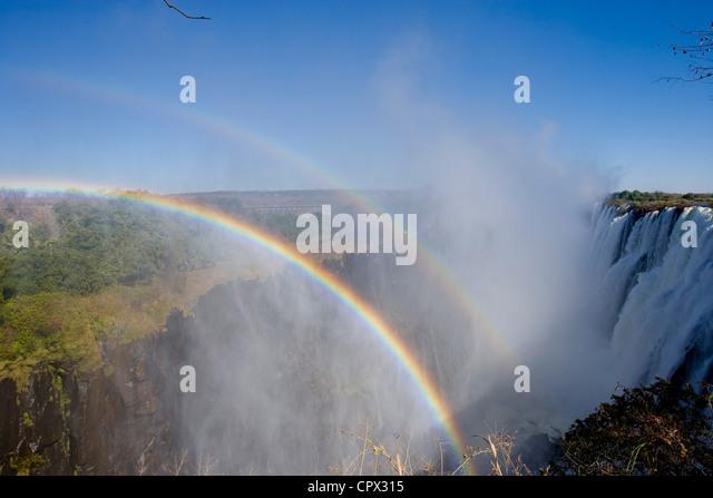 Rainbows over Victoria Falls - Stock Image