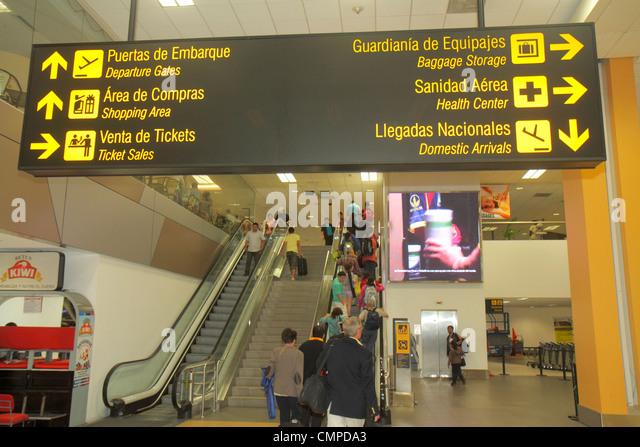 Lima Peru Jorge Chávez International Airport LIM aviation terminal sign bilingual Spanish English information - Stock Image