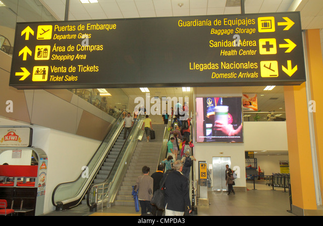Peru Lima Jorge Chávez International Airport LIM aviation terminal sign bilingual Spanish English information - Stock Image