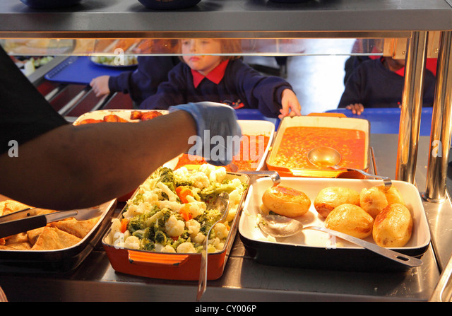 Primary school lunchtime, School Canteen child chooses, school dinner, London, UK - Stock Image