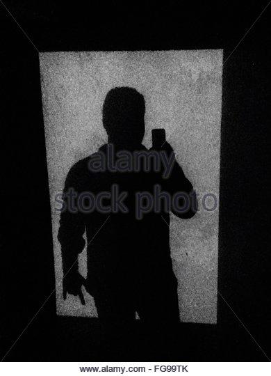 Shadow Of Man On Wall - Stock-Bilder