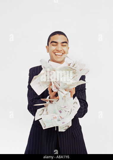 Businessman with lots of money - Stock Image