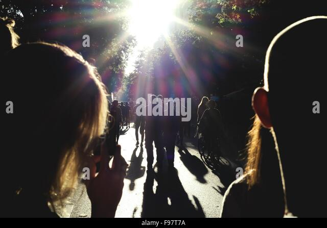 Silhouette People Walking On Road - Stock Image