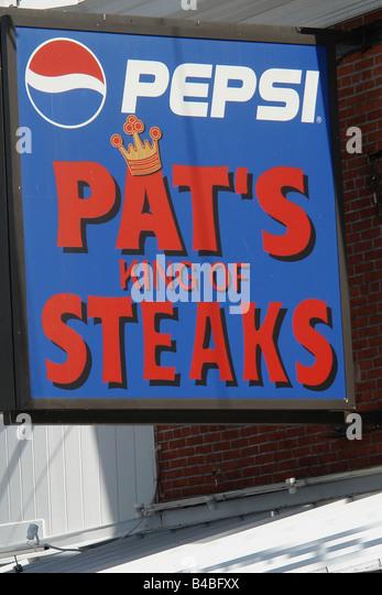 Urban Scene of Landmark Philadelphia Cheesesteak Vendor Pats - Stock Image
