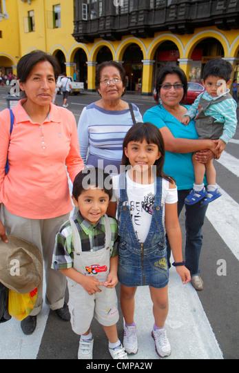Lima Peru Plaza de Armas public square Hispanic woman mature boy girl child mother grandmother son daughter brother - Stock Image