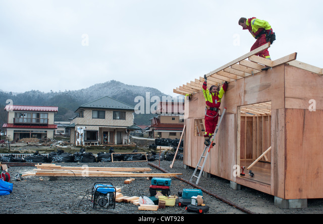 volunteer workers are building an office for local fishermen in onosaki ishinomaki building an office