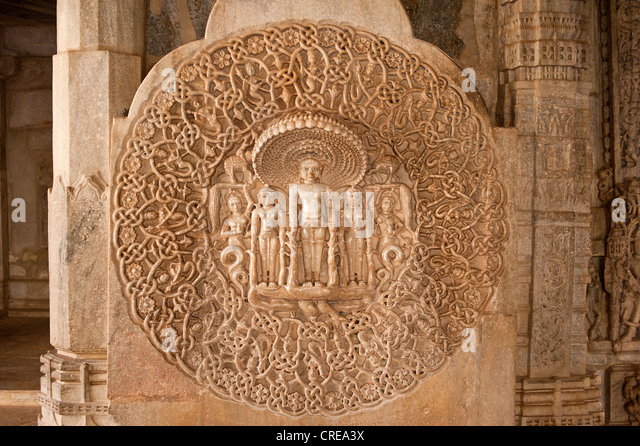Artistic marble wall frieze in the Chaumukha marble temple in Ranakpur, sanctuary of the Jain religion, Rajasthan, - Stock-Bilder