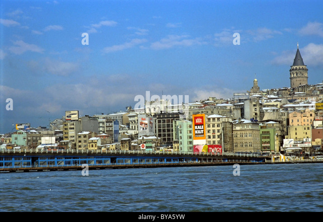 Bosphorus River, Istanbul, Turkey - Galata Bridge, Galata Tower And city district buildings - Stock Image
