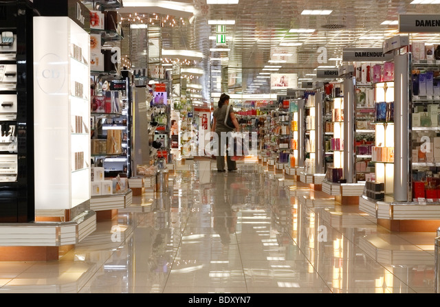 woman in a cosmetics shop - Stock Image