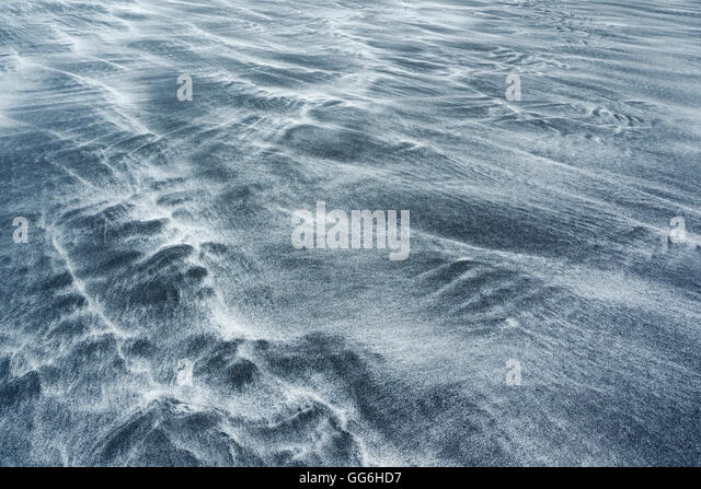 Patterns formed by tidal movements of black volcanic sand and white granulated sea shells at Talisker Bay, Isle - Stock Image