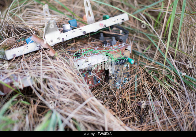 Electronic waste  on grass - Stock Image