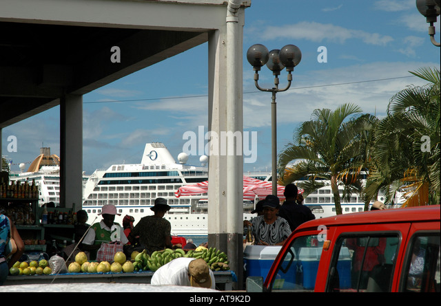 Castries St Lucia produce market saturday cruise ship in background - Stock Image