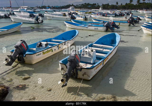 Tour boats at Bayahibe fishing village for day trips to Isla Saona Dominican Republic popular tourist excursion - Stock Image