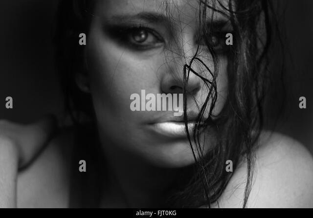 Close-Up Portrait Of Beautiful Young Woman - Stock Image