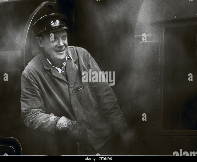 Steam train driver on the Swanage Railway, Dorset, South West England, UK in monochrome - Stock Image