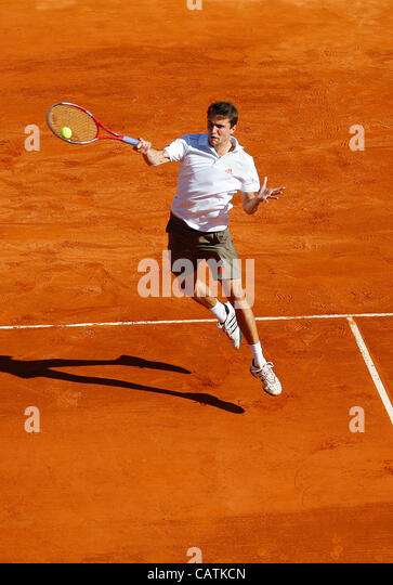 21.04.2012 Monte Carlo, Monaco.  Gilles Simon (FRA) in action against  Rafael Nadal (ESP) during the S-Finall of - Stock Image