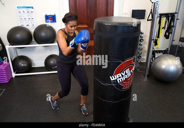 First Lady Michelle Obama demonstrates her boxing skills during a GimmeFive video taping at the White House May - Stock Image