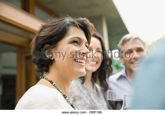 Portrait of woman looking away outdoors - Stock Image