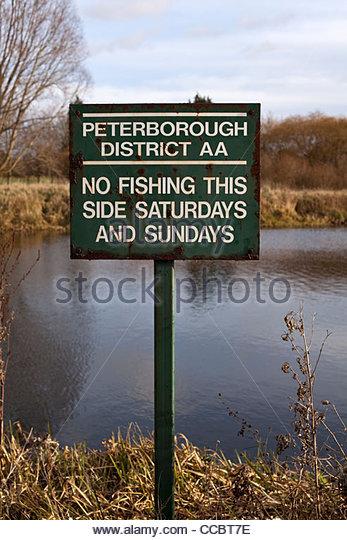 Old and rusty No Fishing sign on the River Nene, Peterborough, Cambridgeshire, UK - Stock Image