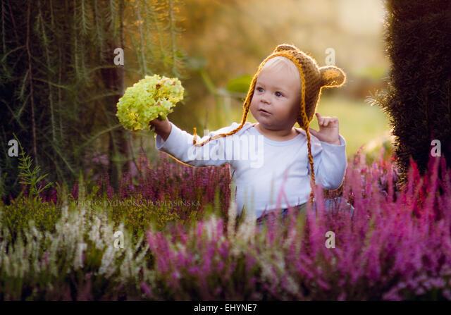 Boy holding flowers - Stock Image