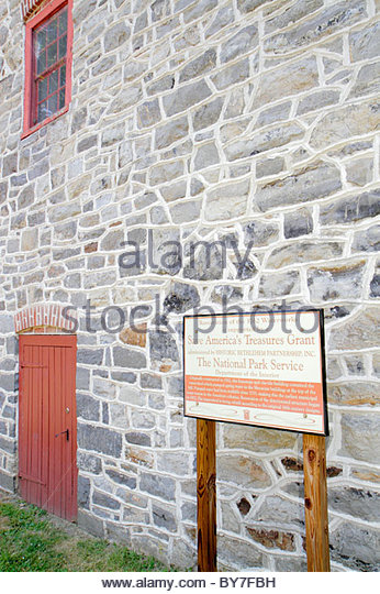 Pennsylvania Bethlehem Old Waterworks Monocacy Creek National Historic Landmark colonial building pump house waterwheel - Stock Image
