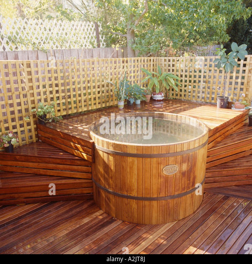 Wooden hot tub stock photos wooden hot tub stock images for Circular garden decking