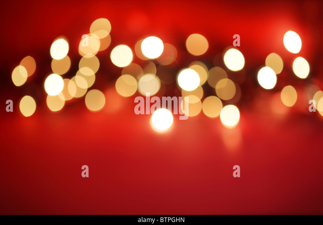Defocussed lights on red - Stock Image