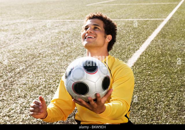 Guy with football - Stock-Bilder