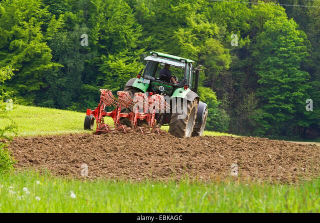farmer plowing a meadow, Germany, Bavaria - Stock Image